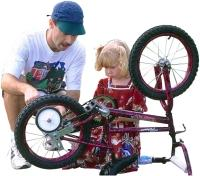 man repairing girl bike small